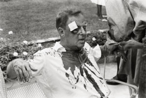 54. White volunteers did not escape assault. Arthur Lelyveld, a rabbi from Cleveland, Ohio, receives first aid after being beaten with a tire iron.Herbert RandallHattiesburg, Mississippi, 1964